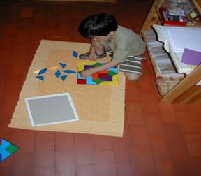 Montessori student shown working on a puzzle.